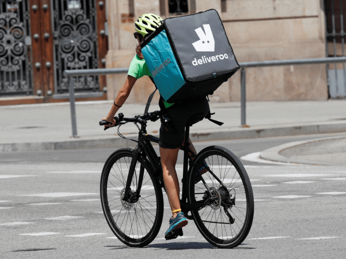 FILE PHOTO: A biker wearing a Deliveroo backpack drives in the central Barcelona, Spain, July 23, 2019. REUTERS/Albert Gea