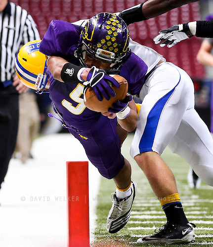 Jayme Allen (5) of the Blue Springs Wildcats dives at the pylon during the 2012 MSHSAA football class 6 state championship game against the Francis Howell Vikings at the Edward Jones Dome on November 24, 2012 in St. Louis, Missouri.
