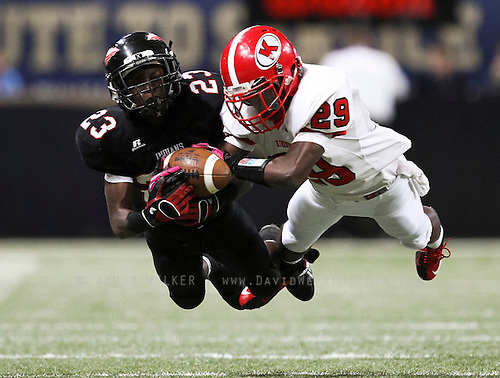 Eric Phillips (29) of the Kirkwood Pioneers catches a ball for an interception in front of Willie Penamon (23) of the Fort Osage Indians during the 2012 Class 5 MSHSAA football state championships at the Edward Jones Dome on November 23, 2012 in St. Louis, Missouri.