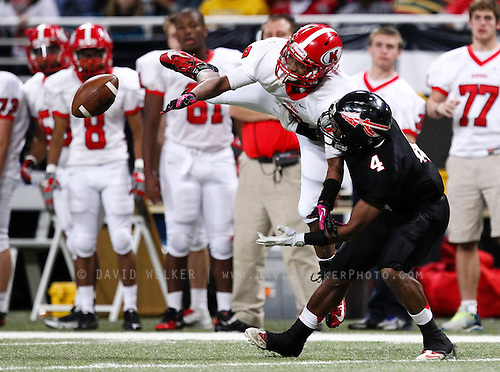 Clyde Benson (9) of the Kirkwood Pioneers is defended by Koida Ejire (4) of the Fort Osage Indians while trying to catch a pass during the 2012 MSHSAA football class 5 state championship game at the Edward Jones Dome on November 23, 2012 in St. Louis, Missouri.