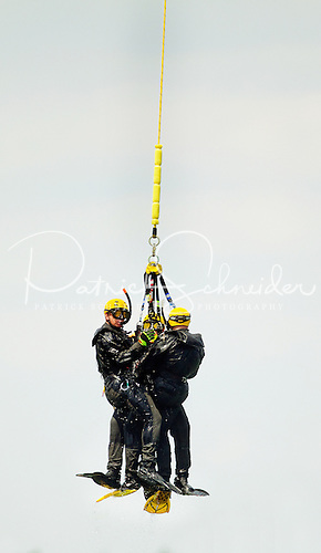 Photography of aquatic rescue team members being lifted from Lake Norman during training exercises in May 2012.