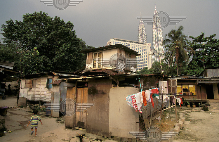 Image result for Poverty in the background of Malaysia's Twin Towers