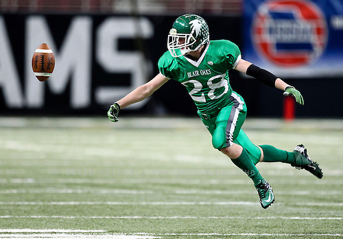 Ashton Maasen (28) of the Blair Oaks Falcons dives for a tipped ball during the 2012 MSHSAA football class 2 state championship game against the Lamar Tigers at the Edward Jones Dome on November 24, 2012 in St. Louis, Missouri.