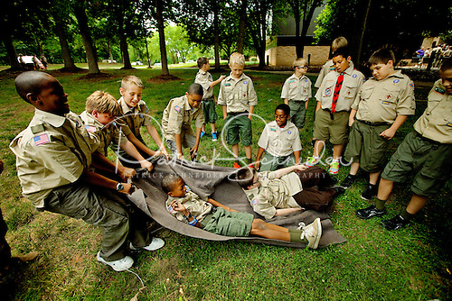 Photo: Boy Scouts work on their first aid merit badge.
