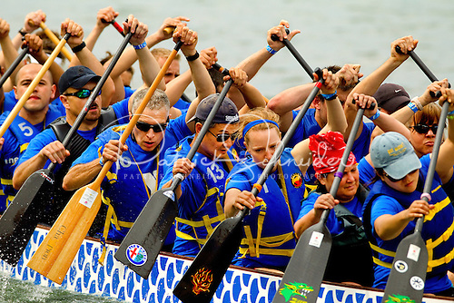 Dragon Boat racers paddle toward the end of the 500-meter course.