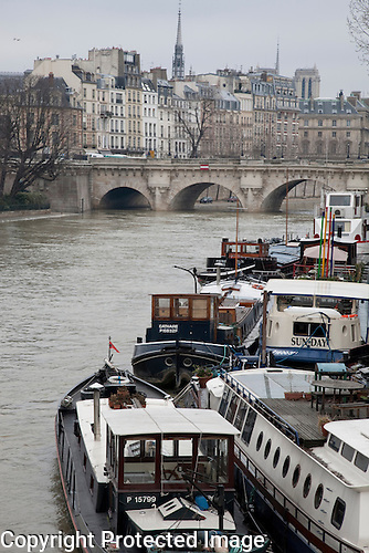 Boats on the River Seine with the Ile de la Cite, Paris, France