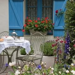 C Spring Patio Chairs Office Ikea Teatime On The Garden | Plant & Flower Stock Photography: Gardenphotos.com