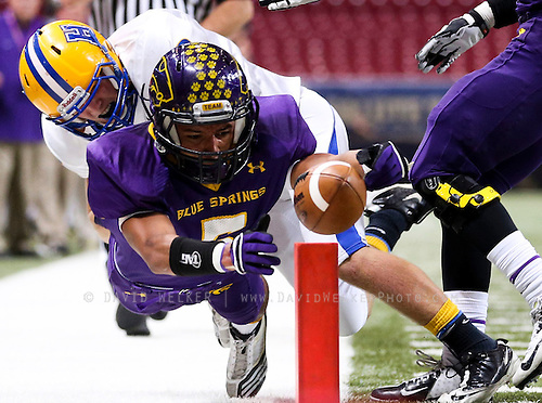 Jayme Allen (5) of the Blue Springs Wildcats stretches for the pylon during the 2012 MSHSAA football class 6 state championship game against the Francis Howell Vikings at the Edward Jones Dome on November 24, 2012 in St. Louis, Missouri.