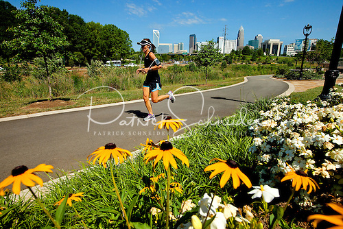 Photography of a woman running along the Little Sugar Creek Greenway in Charlotte NC.