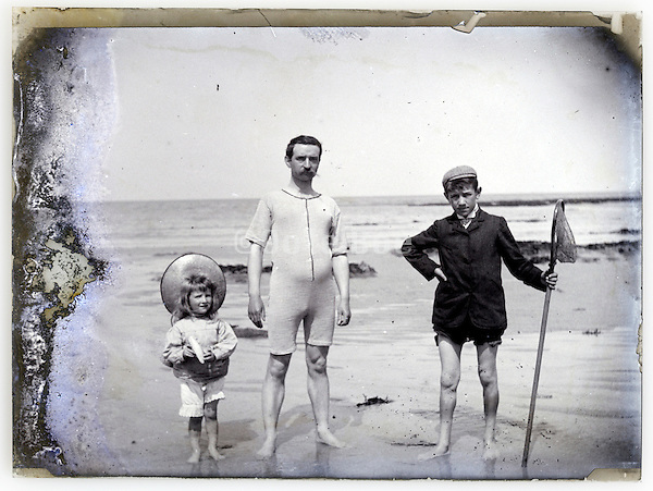 1900s seascape with father in swim suite and children