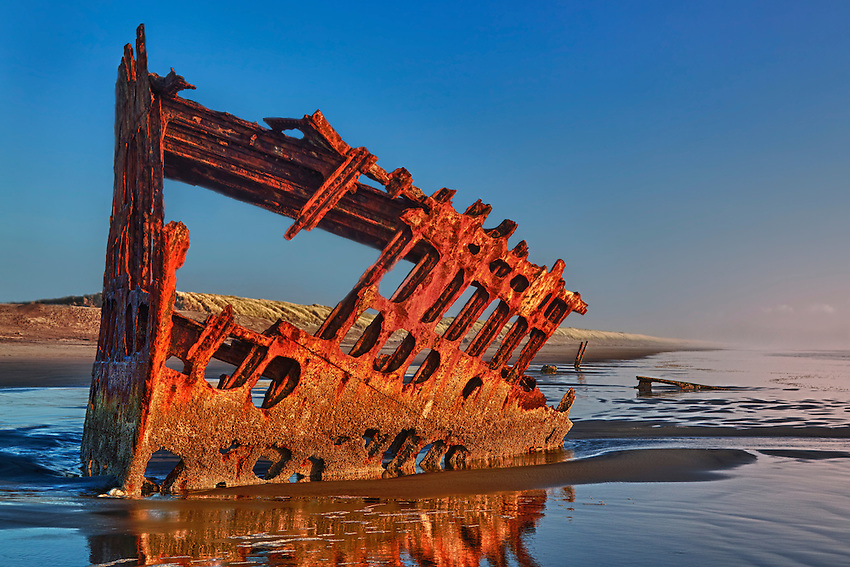 See the remains of the 1906 shipwreck Peter Iredale on the