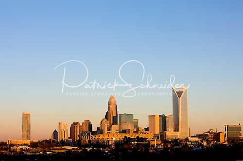 Charlotte skyline photo illustrating sky color transformation as sun sets over Charlotte NC