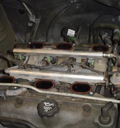 leaking coolant cracked intake manifold gasket  [ 1024 x 768 Pixel ]