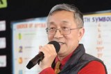 Haoliang Sun speaks into a microphone.