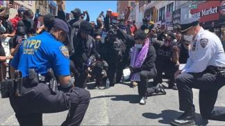 Police Officers Across America Kneel in Solidarity and Pray With Protesters After Death of George Floyd
