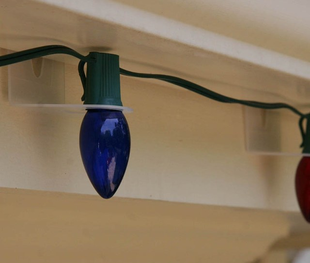 Hang Lights Vertically Under Gutters With Shingle Tabs