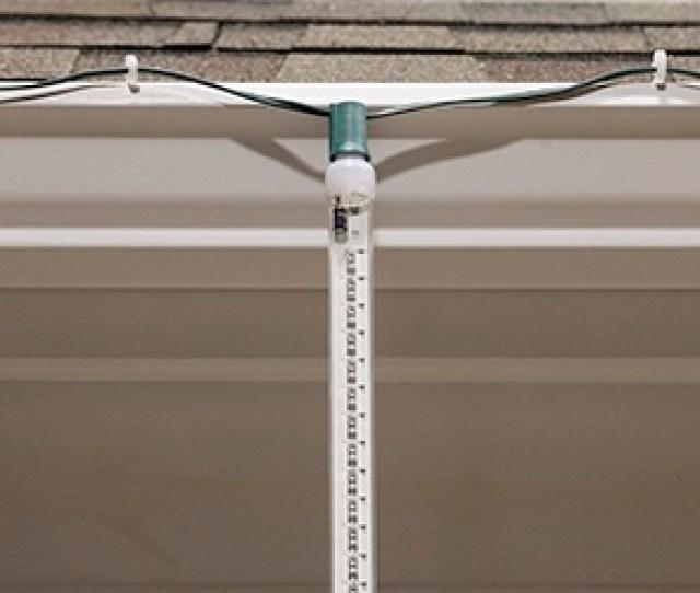 Grand Cascade Led Light Tubes Hang Across The Roof Using Gutters Hooks