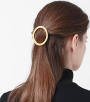 gold hair accessories byrdie