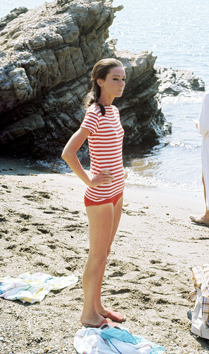 It doesn't get more classic than nautical stripes at the beach. Wear a  striped top over a swimsuit and add a pair of espadrilles.