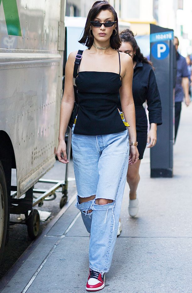7fda4da511f842 Style Notes  Bella gives us some seriously nostalgic vibes with this  super- 00s ensemble. The baggy jeans and the strappy black top remind us  why we loved ...