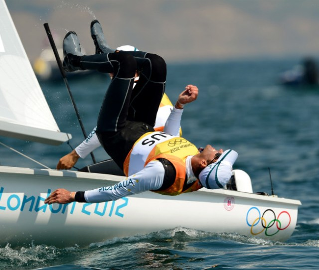 Australias Malcolm Page Leaps Off The Boat As Teammate Mathew Belcher Sails