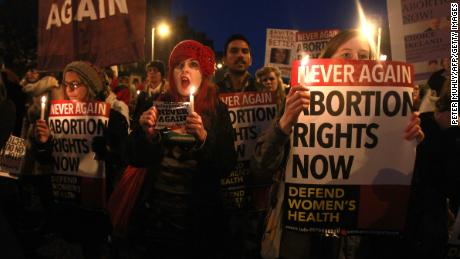 Demonstrators hold placards and candles in memory of Savita Halappanavar in 2012 in Dublin.