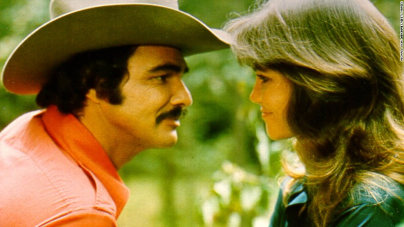 "Reynolds appears with Sally Field in 1977's ""Smokey and the Bandit."""