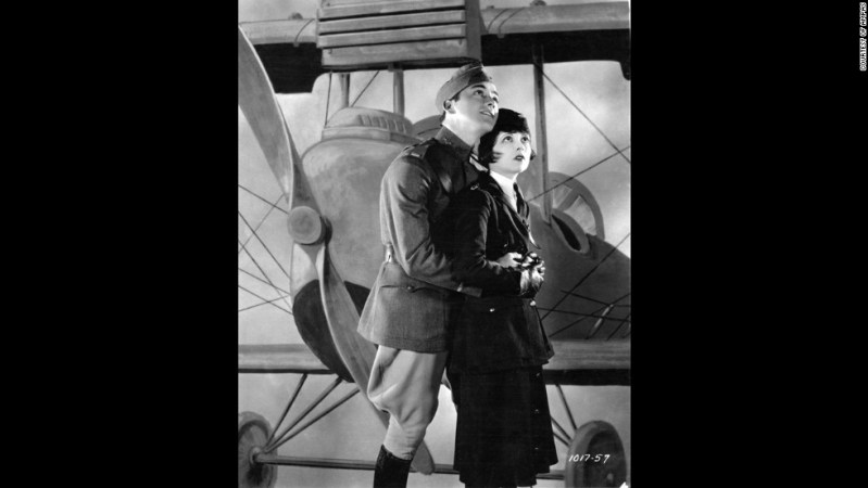 "The first Academy Awards were given out at a dinner on May 16, 1929. The best picture winner was 1927's ""Wings,"" a film about World War I pilots starring Clara Bow, right, Charles ""Buddy"" Rogers, left,  Richard Arlen and Gary Cooper. Even today, the silent film's aerial sequences stand out as some of the most exciting ever filmed. Another film, ""Sunrise,"" was given an Oscar as most ""unique and artistic production,"" an honor that was eliminated the next year. The academy didn't begin using a calendar year for awards until movies made in 1934 (with ceremonies held in 1935). While the Academy awards the Oscars for work from the previous year, we are listing these with the years of the actual ceremony to avoid confusion."