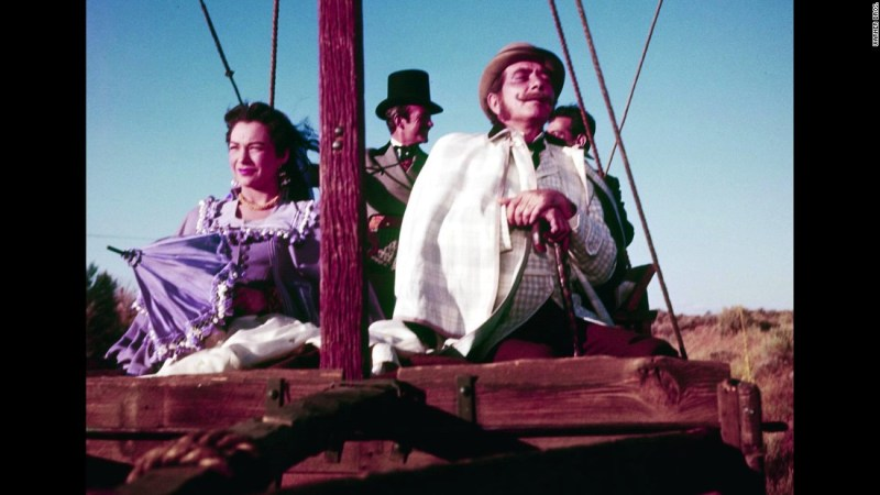 "Responding to the competition from TV, the movies turned increasingly to epics in the 1950s such as producer Mike Todd's ""Around the World in 80 Days."" The picture  was based on Jules Verne's novel and starred Shirley MacLaine, David Niven and Cantinflas as well as dozens of other celebrities in cameo roles, such as Noel Coward, Marlene Dietrich, Red Skelton and Frank Sinatra."