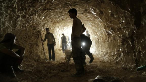 Rebel fighters dig caves in the mountains for bomb shelters in the northern countryside of Hama on March 9, 2015.
