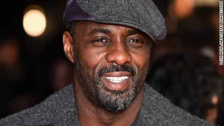 British actor Idris Elba poses for photographers ahead of the World Premiere of 'The Gunman' in central London on February 16, 2015.