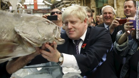Boris Johnson looks at a fish while touring the Mahane Yehuda market in Jerusalem November 10, 2015.