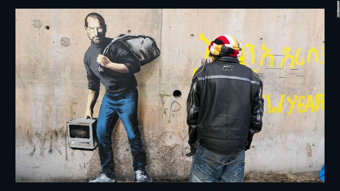 Banksys Steve Jobs Mural Spotlights Refugee Crisis CNN