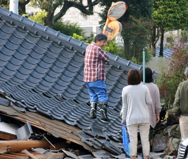 Residents Look For An Access To Their Homes On A Road Blocked By A Collapsed House Photos Earthquakes Strike Japan