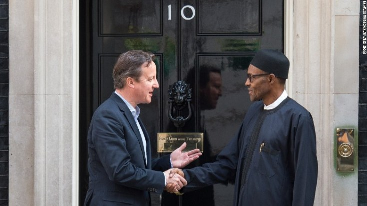 "British Prime Minister David Cameron and Nigeria's President Muhammadu Buhari shake hands. Cameron recently called Nigeria ""fantastically corrupt"" in comments before an anti-corruption summit in London."