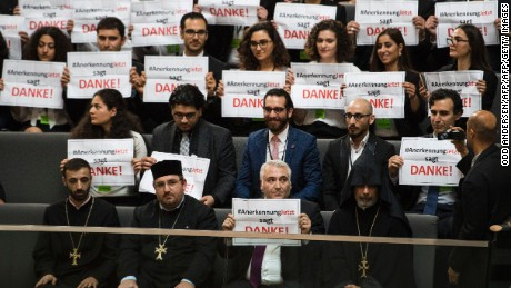Armenian clergy and activists react after German lawmakers vote to recognise the Armenian genocide after a debate in the Bundestag in Berlin on June 2, 2016.