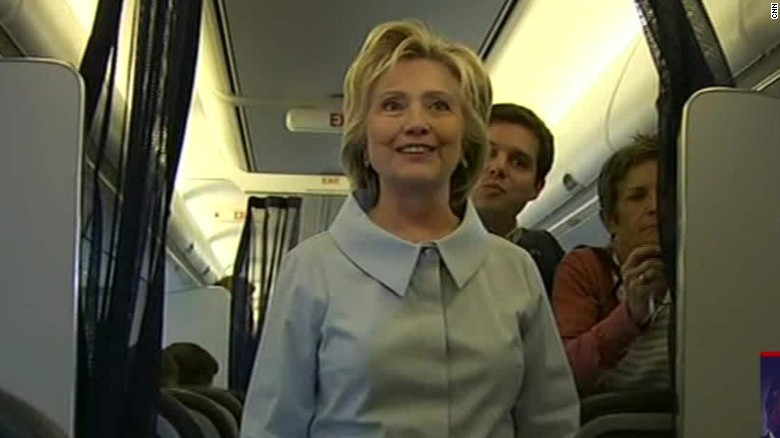 clinton welcomes press aboard