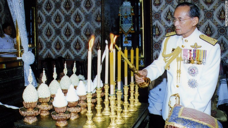 The King lights candles at a ceremony to mark Coronation Day in Bangkok in 2007.
