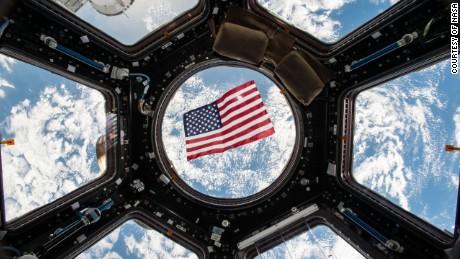 Image Kjell Lindgren released on social media of the US flag floating in the Cupola module.