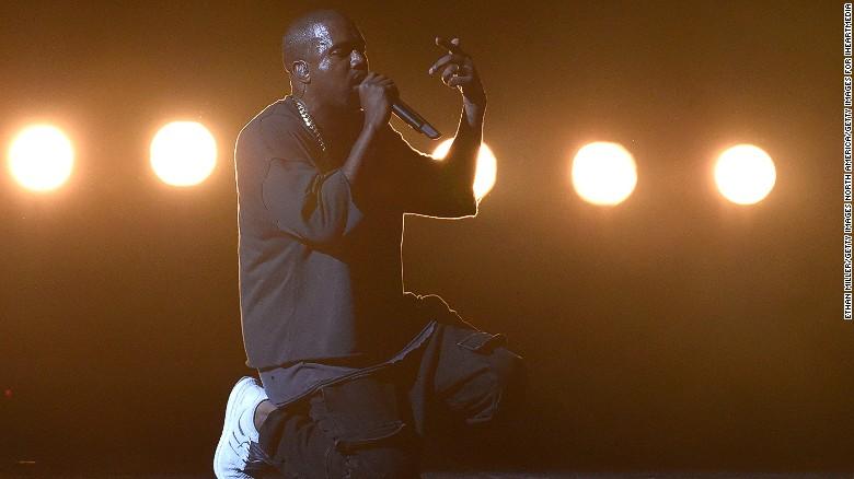 Image result for rapper kanye west praying