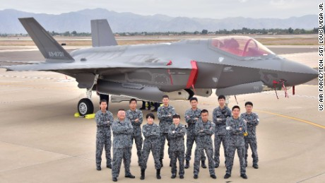 The Japanese Air Self-Defense Force maintainers pose for a photo during the arrival of the first Japanese F-35A at Luke Air Force Base, Arizona.