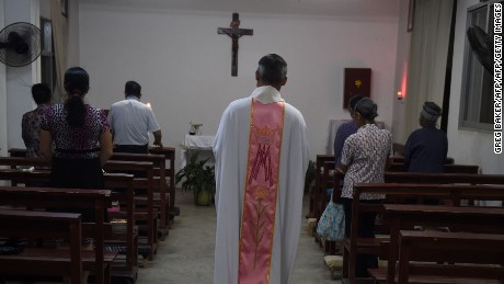 This photo taken on May 11, 2016 shows a priest about to start a mass at the Catholic church in Dingan, in China's southern Guangxi region.