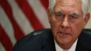 Tillerson raps China as 'predatory' rule breaker