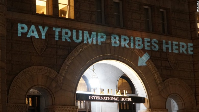 Pay Trump bribes here' sign projected onto Trump's DC hotel - CNNPolitics