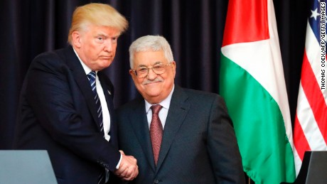 US President Donald Trump, left, and Palestinian leader Mahmoud Abbas shake hands at the presidential palace in  Bethlehem on May 23, 2017.