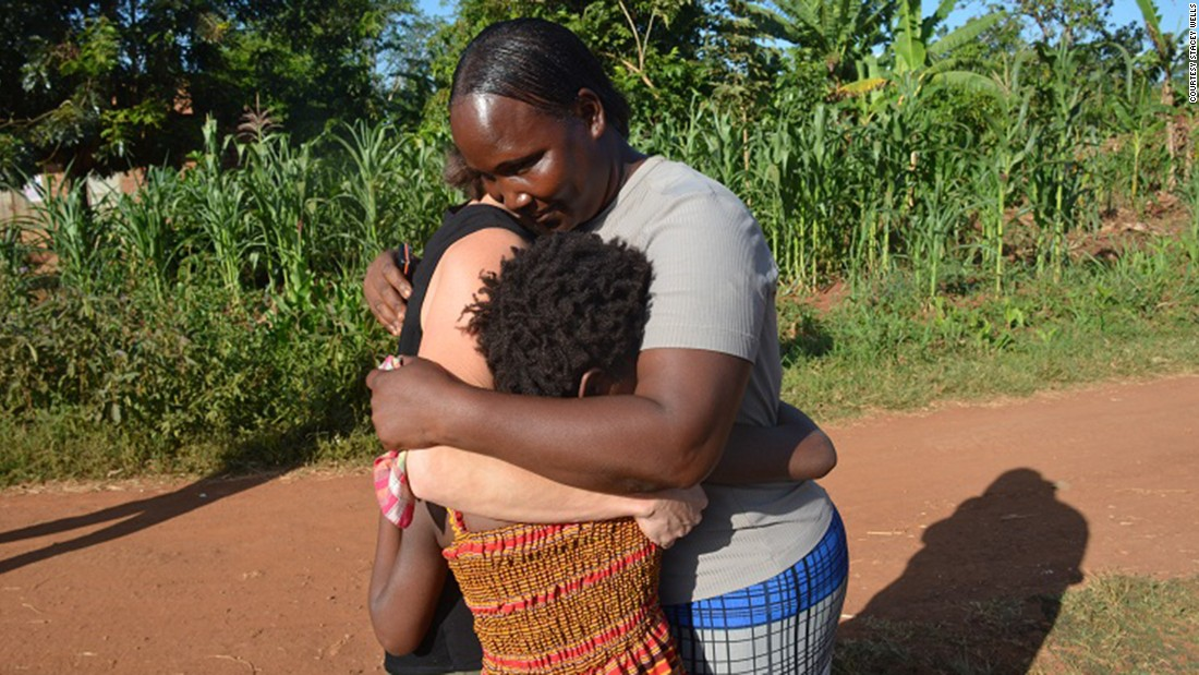 "Violah's mother embraces her daughter and Stacey Wells, the woman who adopted Violah and then returned the girl to her Ugandan village. ""I'm very happy and very grateful,"" Violah's mother said.<br />"
