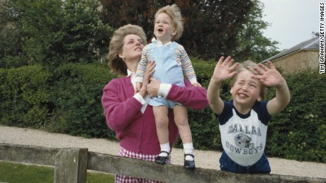 Princes William and Harry with their mother, Diana, in the garden of Highgrove House in Gloucestershire, England in 1986.