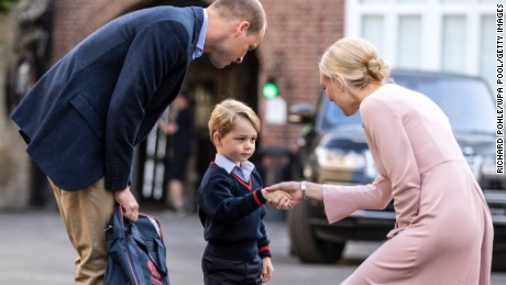 Prince George arrives for his first day of school with his father Prince William on September 7.