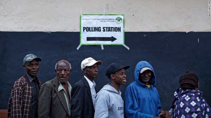 Kenyans queue to vote just after dawn on Thursday.