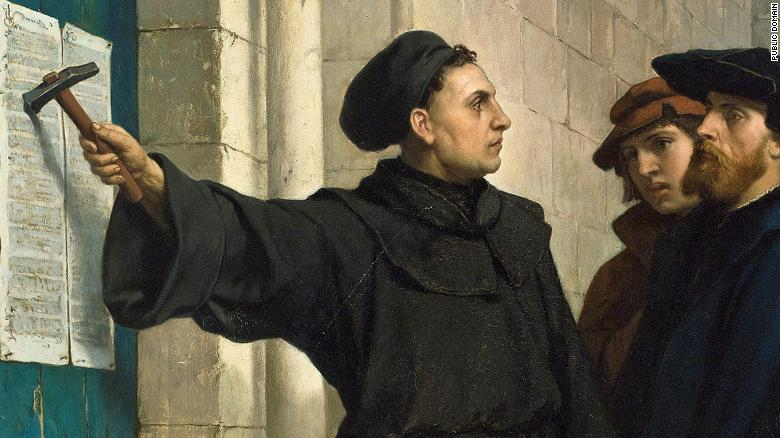 Martin Luther posting his 95 theses on the church door in Wittenberg, Germany.